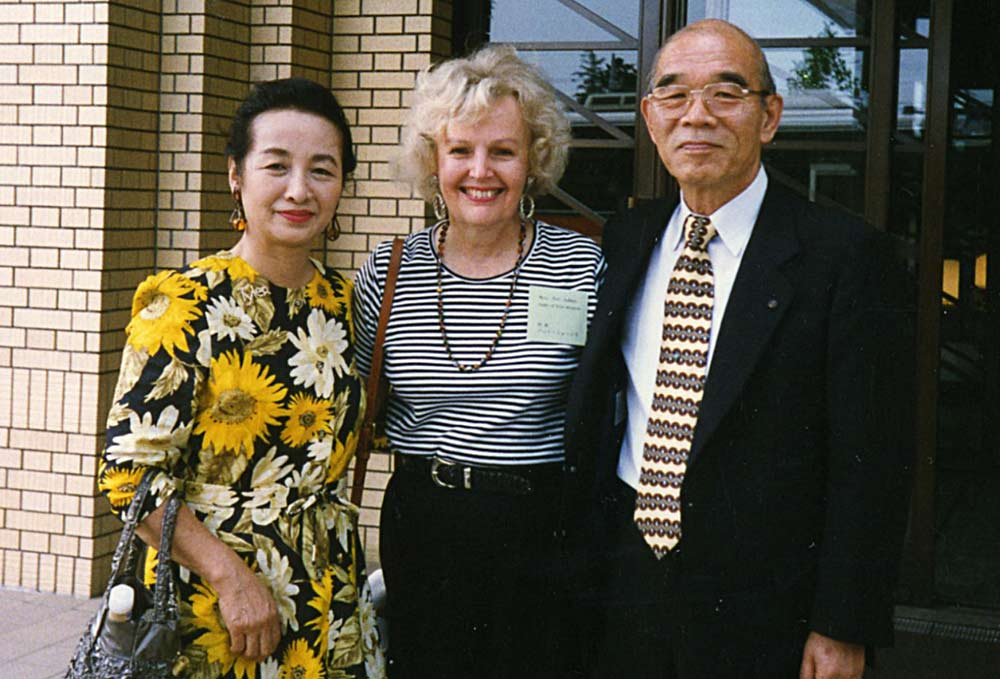 Mr. and Mrs. Sugo of Yachiyo, with Pat Johns, center